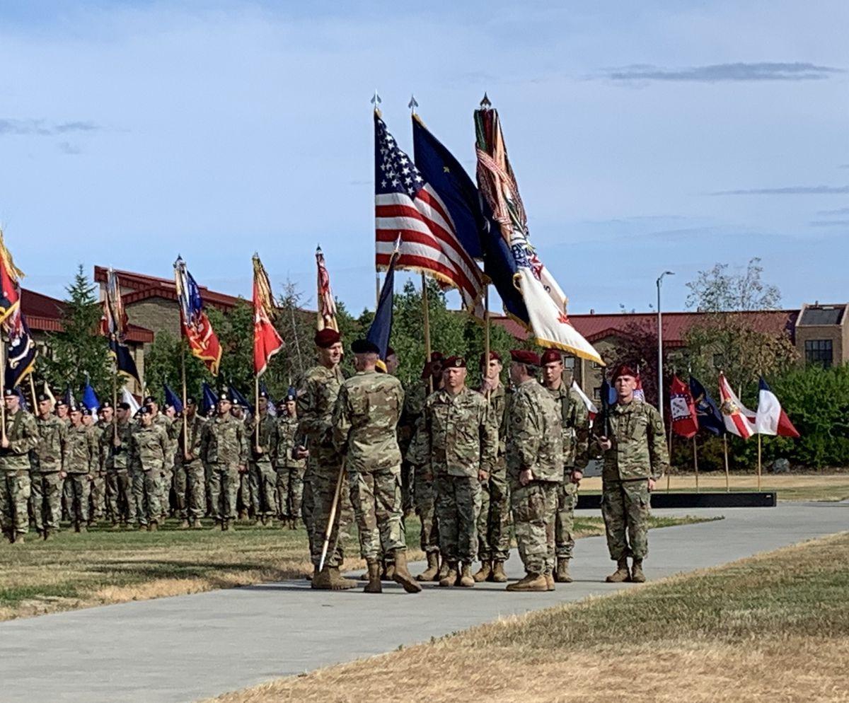 Maj. Gen. Peter B. Andrysiak Jr. accepts the U.S. Army Alaska flag from Lt. Gen. Gary J. Volesky during Maj. Gen. Andrysiak's change of command ceremony July 16, 2019. (Jeff Parrott / ADN)