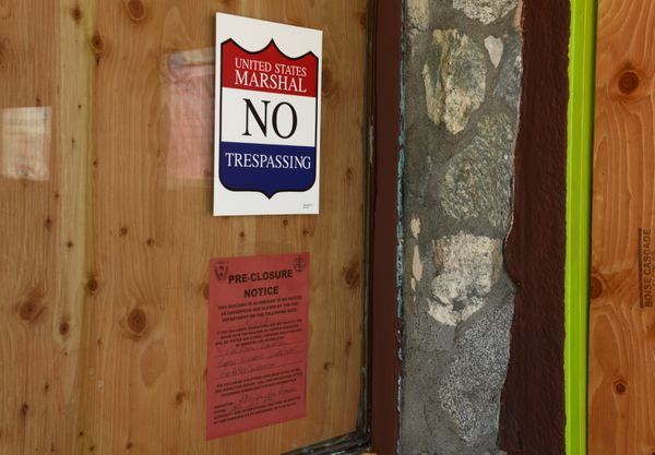 Many signs are posted on the walls of the Spenard Paradise Inn now that it is in federal receivership. (Bob Hallinen / ADN)