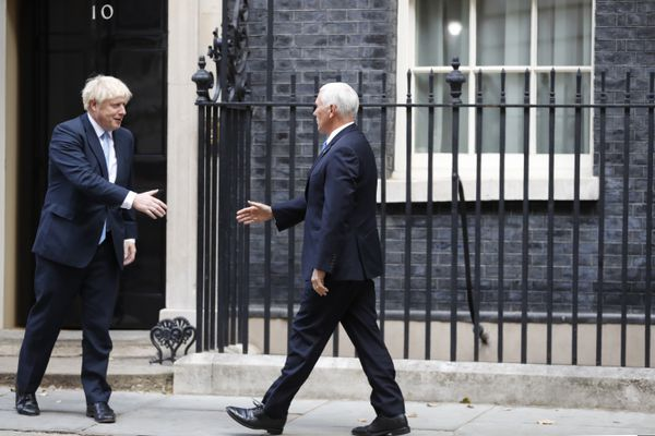 British Prime Minister Boris Johnson, left, welcomes U.S. Vice President Mike Pence prior to a meeting at Downing Street in London, Thursday, Sept. 5, 2019. (AP Photo/Alastair Grant)