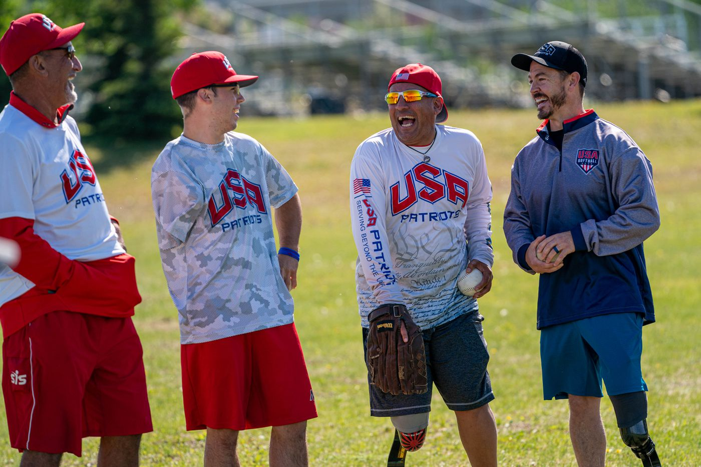 From left, Kai Schjang, Scotty Fura, Jr, Ben Mitchell and Tim Horton laugh while working with Special Olympics athletes Friday at Clark Middle School. (Loren Holmes / ADN)