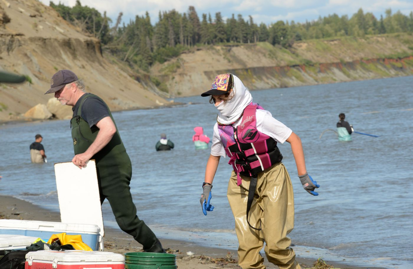 A dipnetter has a well-covered face while fishing for salmon in the Kenai River on Tuesday. (Anne Raup / ADN)