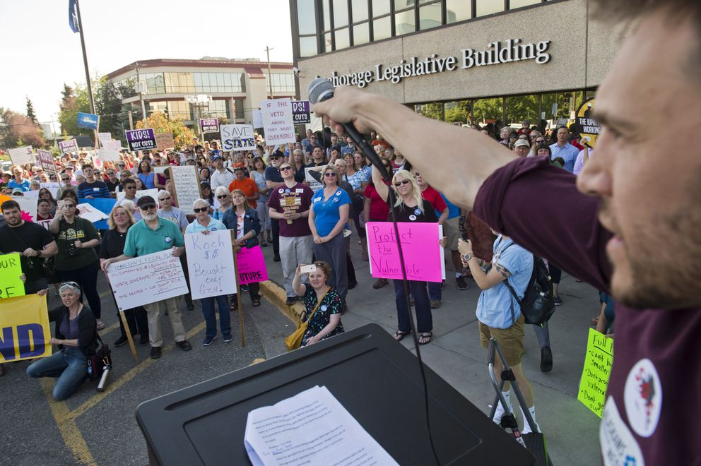 Opponents of Gov. Mike Dunleavy's budget vetoes gathered to rally outside the Legislative Information Office in Anchorage on July 2, 2019. (Marc Lester / ADN)