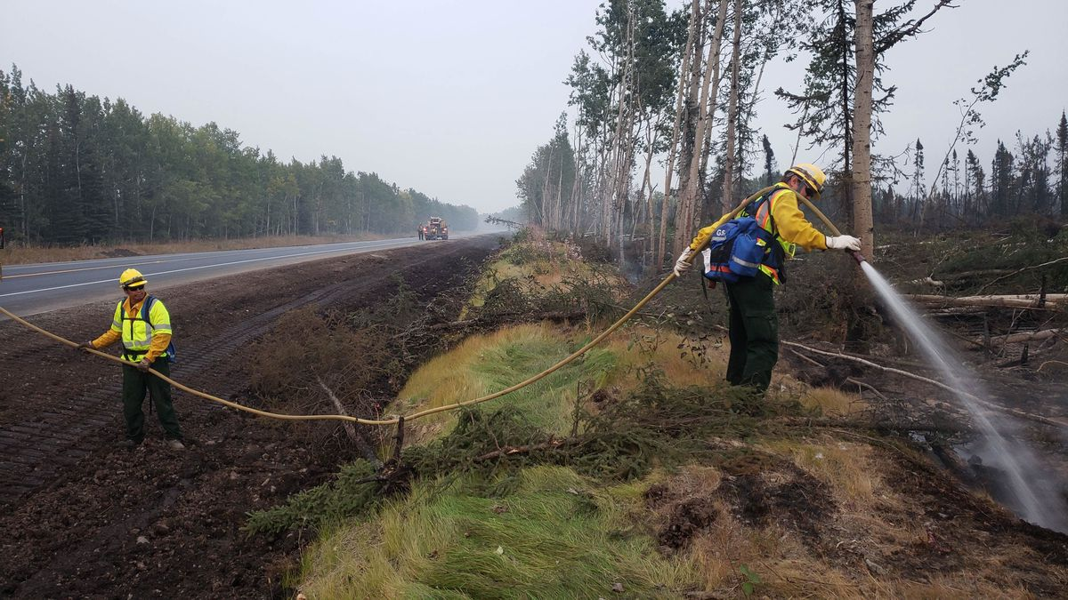 Firefighters mop up hot spots from the Swan Lake Fire along the Sterling Highway on Aug. 29, 2019. (Alaska Fire Services)