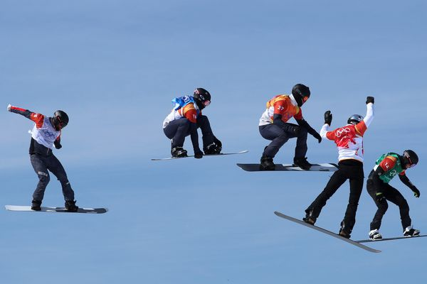 Snowboarding - Pyeongchang 2018 Winter Olympics - Men's Snowboard Cross - Phoenix Snow Park - Pyeongchang, South Korea - February 15, 2018 - Paul Berg of Germany competes with Lukas Pachner of Austria, Mick Dierdorff of the U.S. Jonathan Cheever of the U.S. and Regino Hernandez of Spain. REUTERS/Mike Blake SEARCH