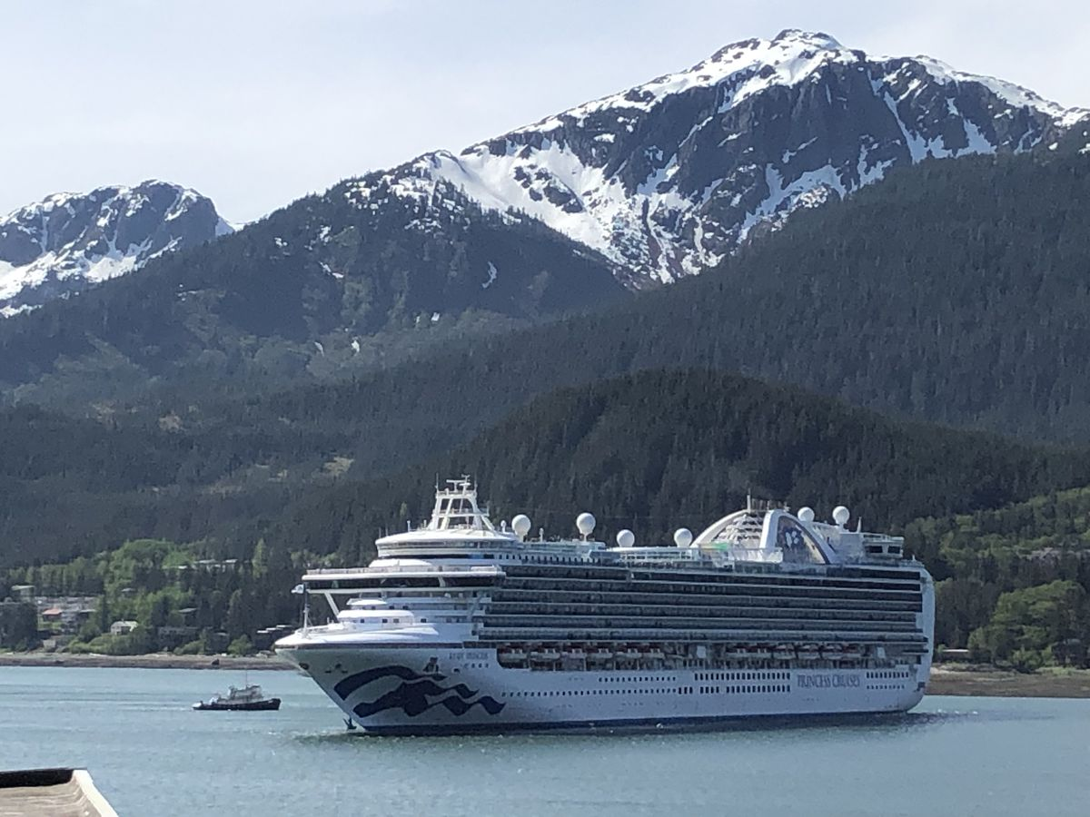 A tugboat escorts the Princess Cruises cruise ship Ruby Princess into the Port of Juneau on Monday, May 20, 2019. Mount Jumbo, officially known as Mount Bradley, is seen on Douglas Island in the background. (James Brooks / ADN)