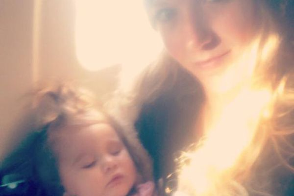 Cody Lee and her 13-month-old daughter Frankie Quinn on a flight to Unalaska Thursday, Oct. 17, 2019. The flight with 42 people on board went off the runway, killing one passenger. (Photo provided by Cody Lee)