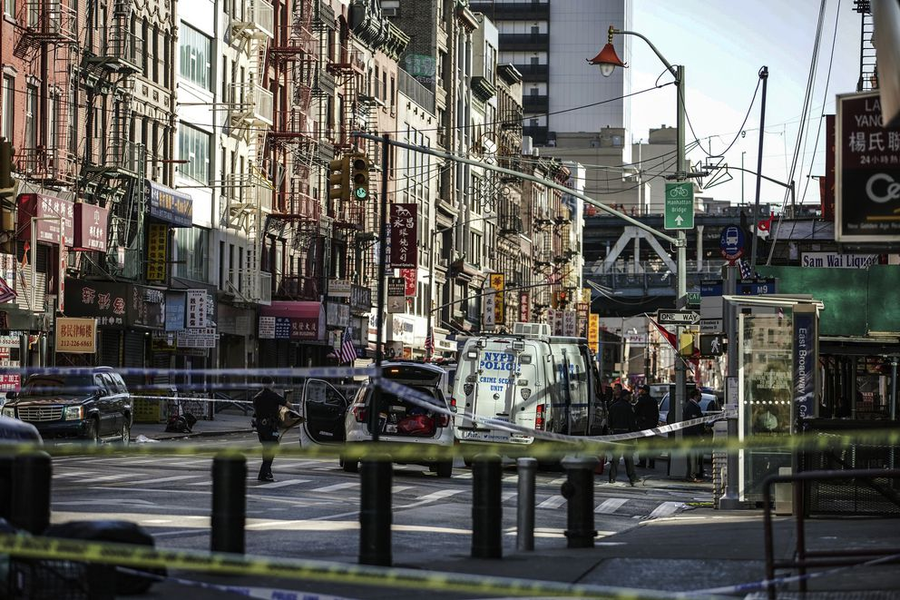 New York Police Department officers investigate the scene of an attack in Manhattan's Chinatown neighborhood, Saturday, Oct. 5, 2019 in New York. (AP Photo/Jeenah Moon)