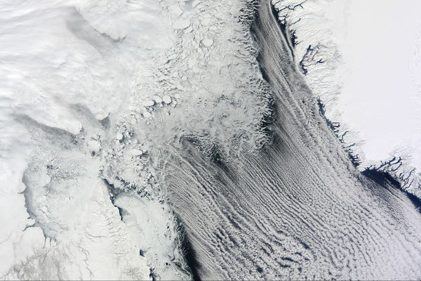 This April 9, 2015 natural-color satellite image shows sea ice and cloud streets between Labrador (Canada) and Greenland. A recent study finds that increases in cloud cover can cause increases in the meltwater running off Greenland's ice sheet.