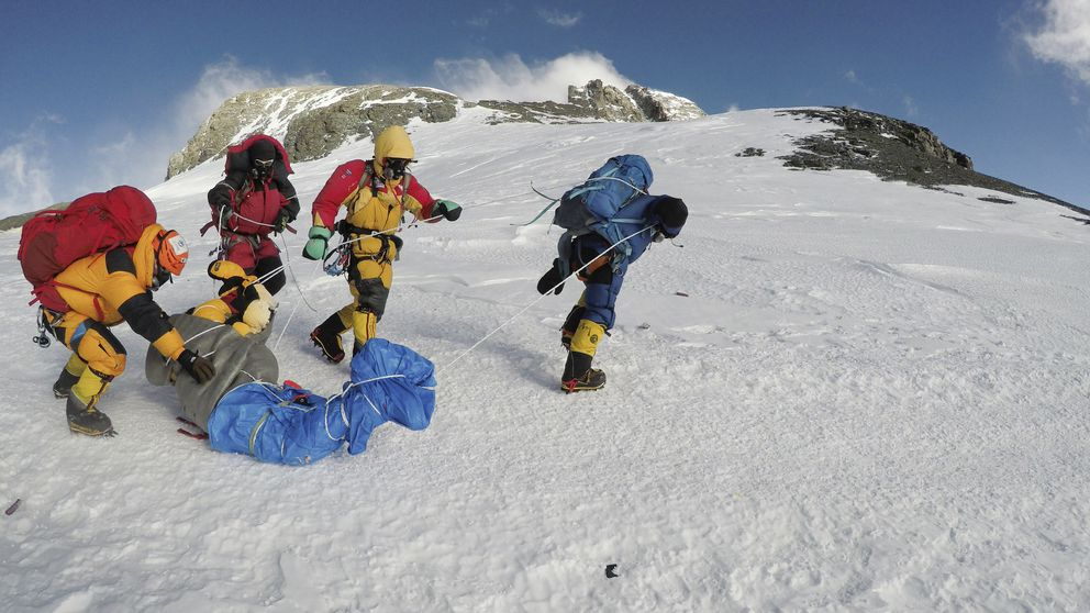 The body of Goutam Ghosh is brought down Mount Everest by Sherpas from Seven Summit Treks, Kathmandu, Nepal, May 2017. Sherpas took on a quest to find the bodies of climbers Ghosh and Paresh Nath — a year after they were abandoned near the top of Everest — and bring them home. (Dawa Finjhok Sherpa/Seven Summit Treks/The New York Times)