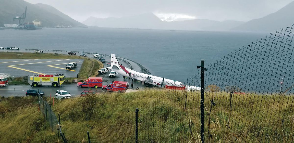 Rescue crews respond to a plane crash at the end of the runway at the Unalaska airport on Oct. 17. (Photo by Erin Enlow)