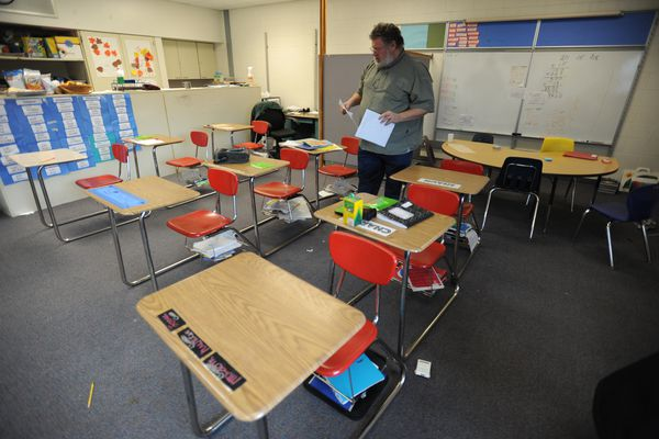 Teacher Mike Saffle walks through his 3rd & 4th grade classroom at Mt. Iliamna Elementary School on JBER. The Anchorage School District plans to close the K-5 school for students with behavioral and cognitive issues at the end of this school year. Wednesday, Nov. 30, 2016. (Bill Roth / Alaska Dispatch News)