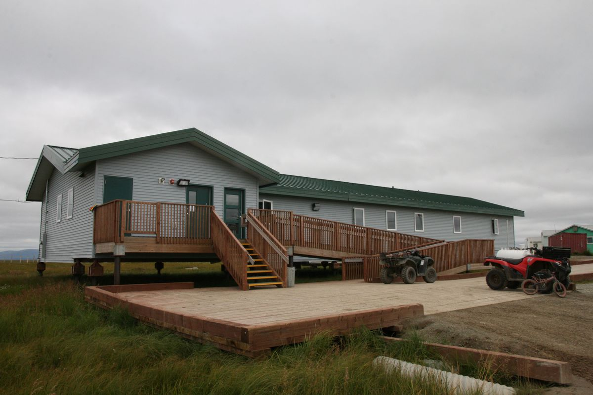 The year-old health clinic in the Southwest Alaska village of Chevak includes modern telemedicine equipment, numerous exam rooms and a bunkroom for visiting providers. Many patients arrive on four-wheelers, as seen from the outside on Thursday, Aug. 11, 2016. (Lisa Demer / ADN)