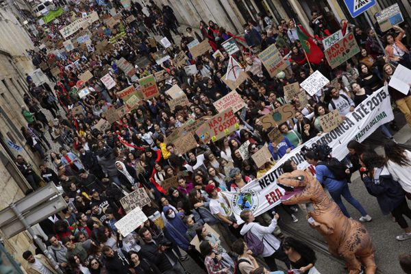 Demonstrators carrying posters and shouting slogans march through Lisbon during a worldwide protest demanding action on climate change, Friday, Nov. 29, 2019. Many students worldwide are skipping class Friday to take to the streets to protest their governments' failure to take sufficient action against global warming. (AP Photo/Armando Franca)