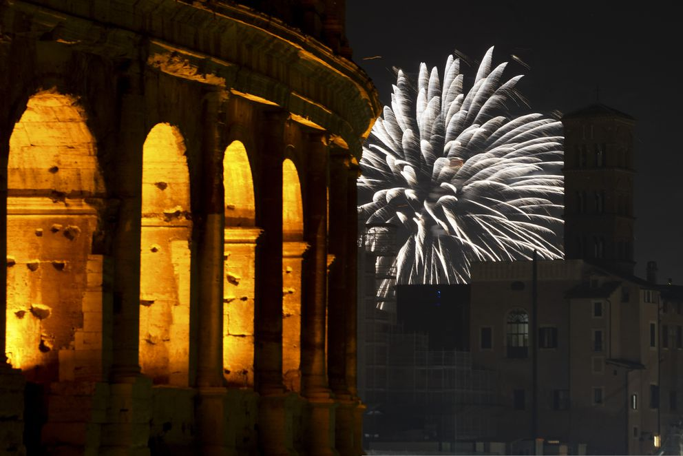 Fireworks explode in the sky next to Rome's Colosseum during New Year's celebrations, in Rome, Friday, Jan. 1, 2021. Italy went into a modified nationwide lockdown for the Christmas and New Year period, with restrictions on personal movement and commercial activity similar to the 10 weeks of hard lockdown Italy imposed from March to May when the country became the epicenter of the outbreak in Europe. (AP Photo/Andrew Medichini)