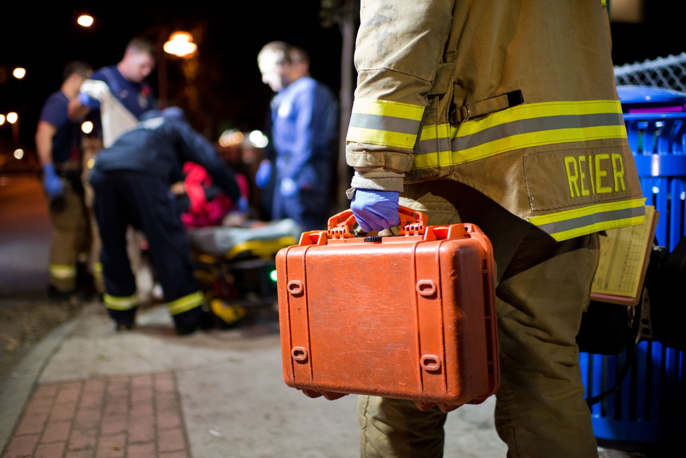 "Anchorage Firefighters assist a woman near 13 Avenue and Hyder Street. The intoxicated woman complained of an heart rhythm irregularities and was transported to a hospital. Medic Matt Eckart said the demands on the fire department by intoxicated people can wear down firefighters. ""We take them to the hospital, they release them, they go to Anchorage Safety Patrol and they just sober up to get out and go do this – drinking – again. It's just a big cycle,"" he said. Photographed on Friday, October 17, 2014. Marc Lester / ADN"
