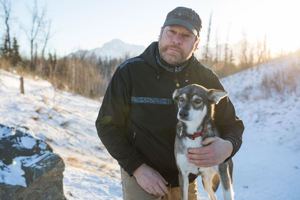 Bill Mohrwinkel with his dog Remi at the Crevasse Moraine Trailhead in Palmer on Friday, Jan. 6, 2017. The trails are adjacent to areas used by trappers, and Remi was caught in a trap last month, but was not injured. (Loren Holmes / Alaska Dispatch News)