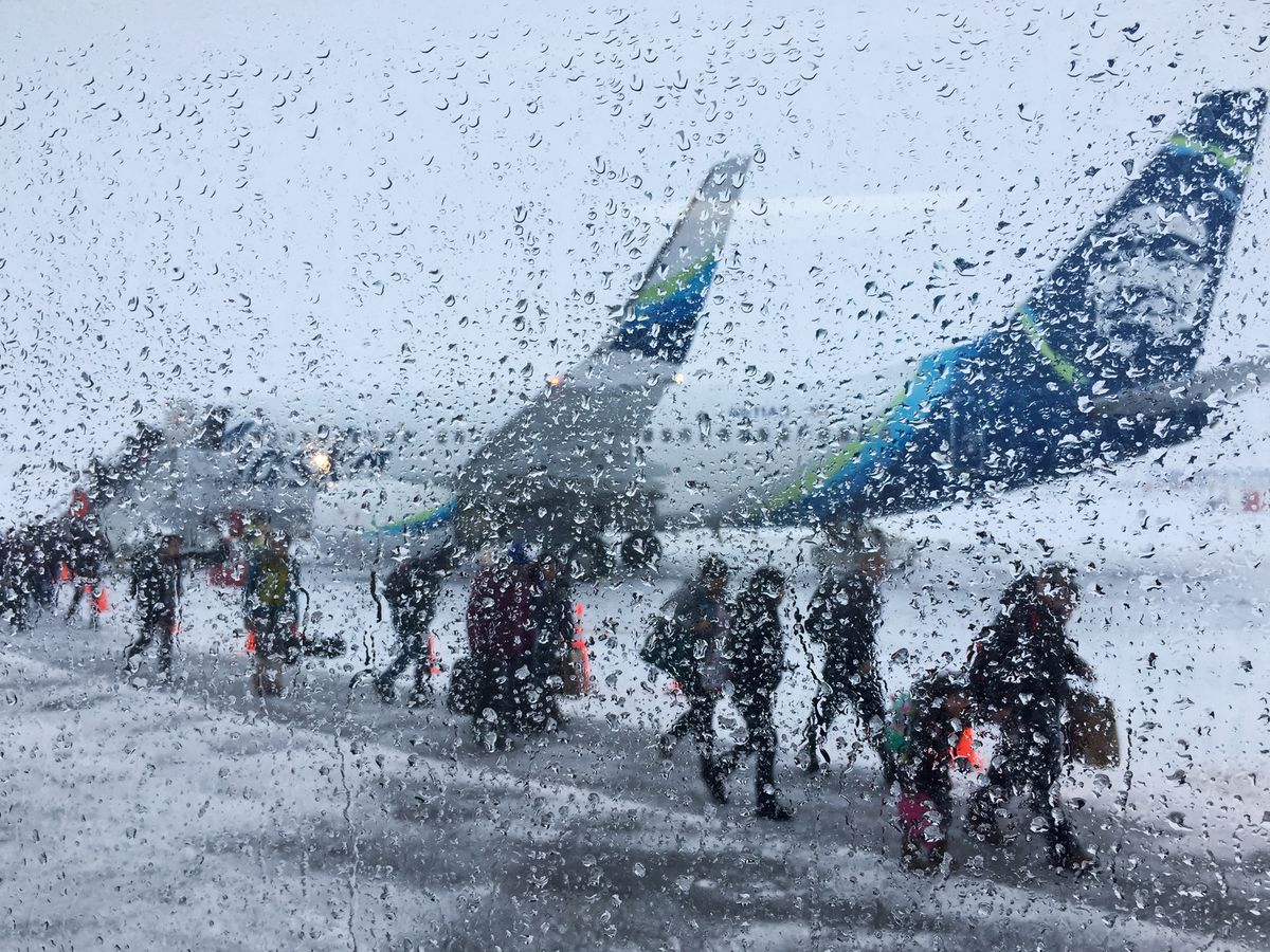 Travelers exit a plane in Nome after a flight on March 18, 2020. (Marc Lester / ADN)
