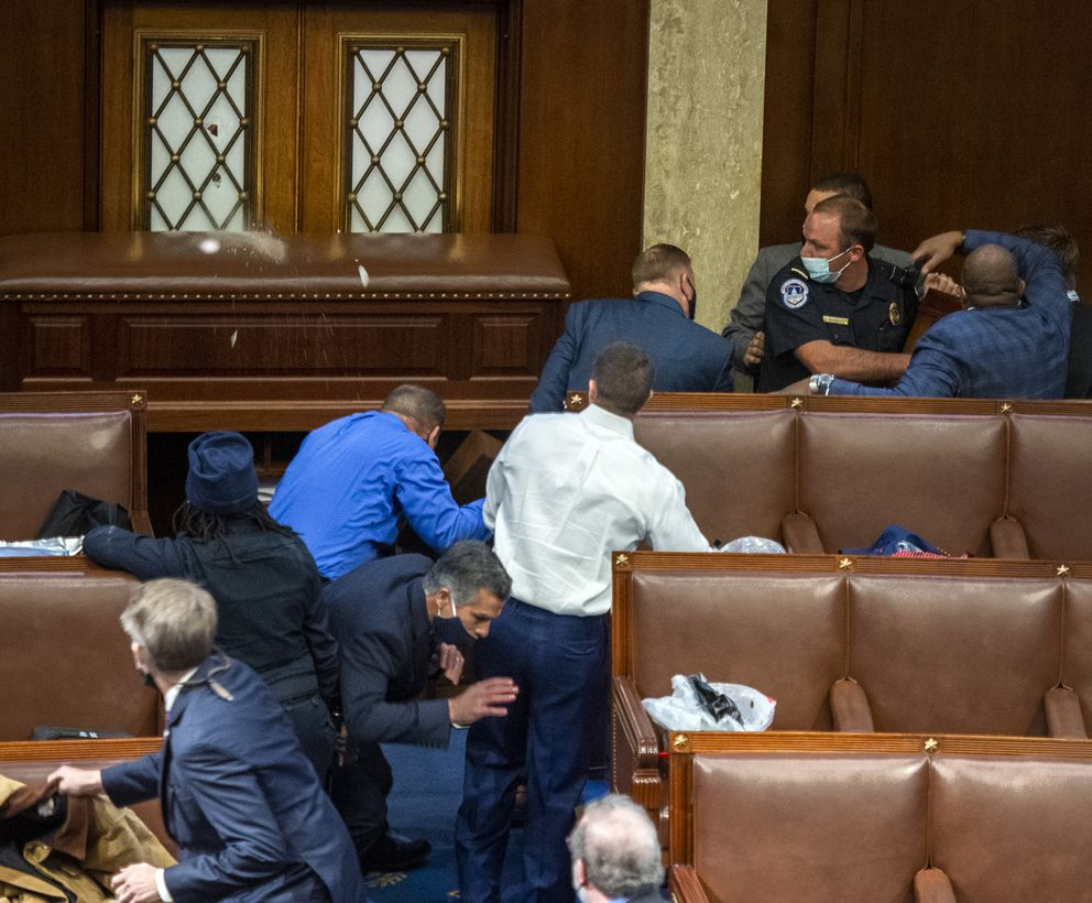 People inside the House chamber react as a window is broken, apparently by gunshots, on Wednesday. Pro-Trump protesters were outside the doors. Washington Post photo by Bill O'Leary.