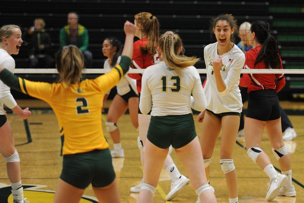 UAA sophomore Eve Stephens, right, celebrates one of her team high 15 kills during the Seawolves' 3-0 home victory over Saint Martin's Saints at the Alaska Airlines Center on Thursday, Nov. 21, 2019. (Bill Roth / ADN)
