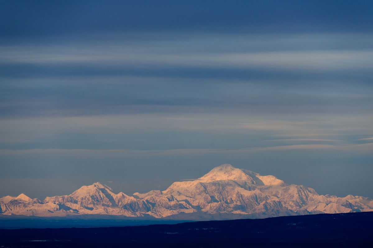 Denali catches sunlight on a day that was mostly overcast in the Anchorage area. This view is from Skyline Drive in Eagle River on January 16, 2019. (Marc Lester / ADN)