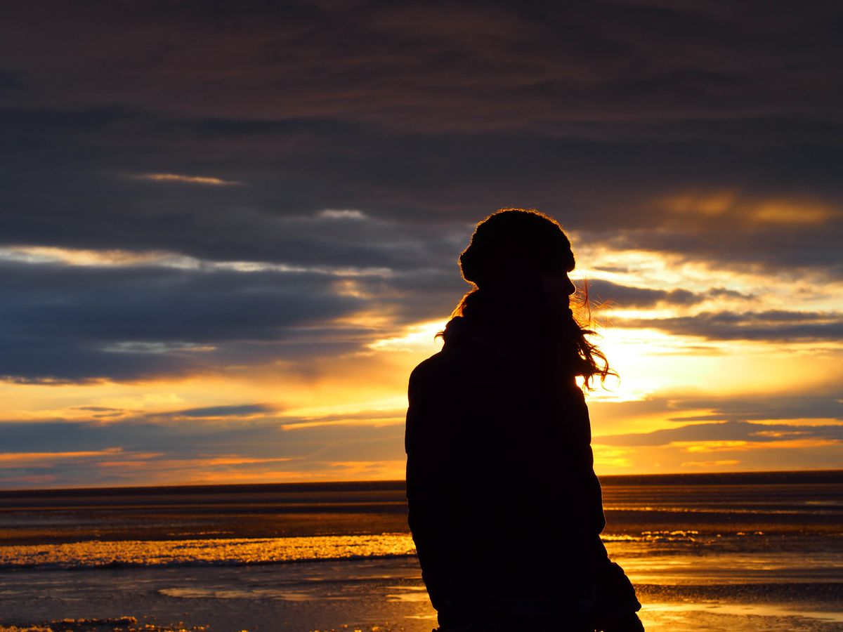 Laureli Ivanoff faces the ocean on the beach of Unalakleet. (Zach Hughes)