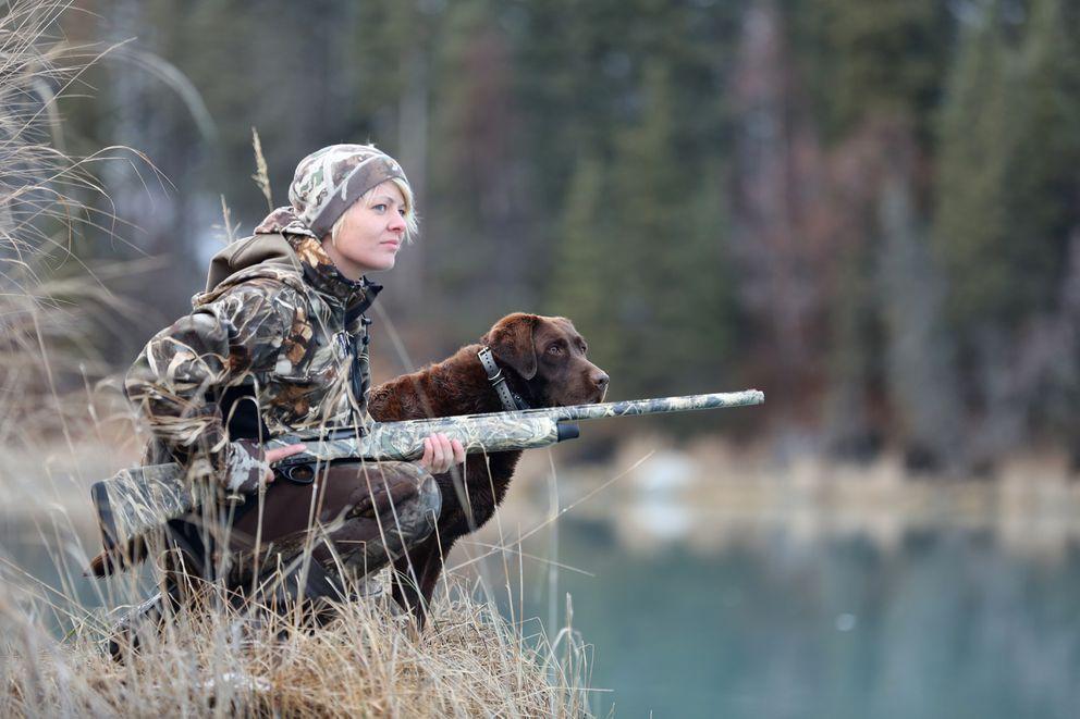 Christine Cunningham and her dog Cheyenne hunt along the Kasilof River in 2015. (Steve Meyer)