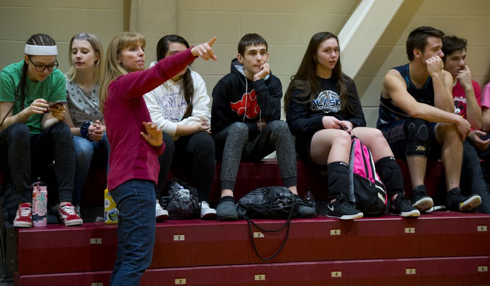 Nikolaevsk coach Bea Klaich talks with her team after practice at Dimond High. (Marc Lester / ADN)