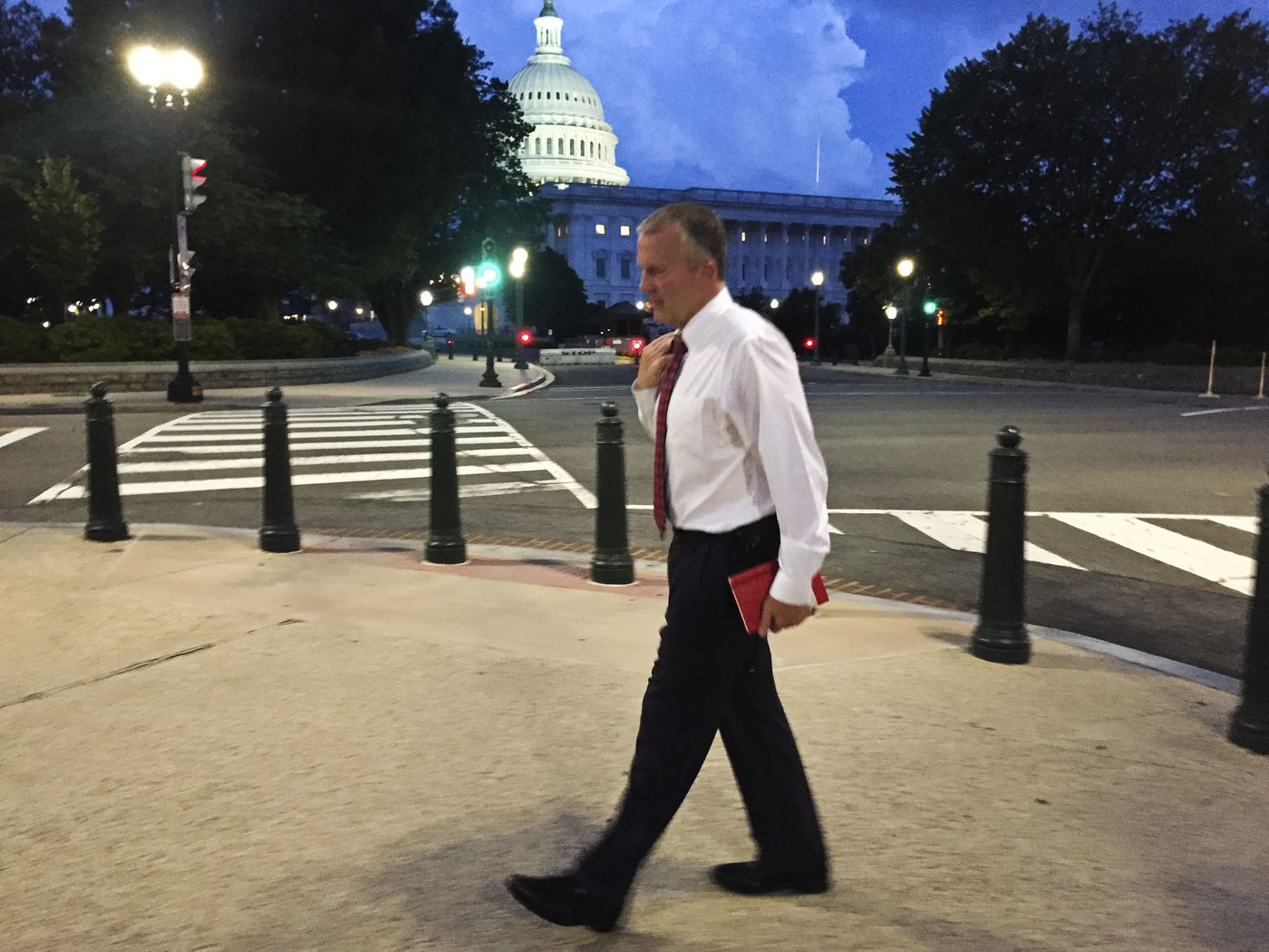 Sen. Dan Sullivan walks home at the end of a Washington workday on June 19, 2019. (Marc Lester / ADN)