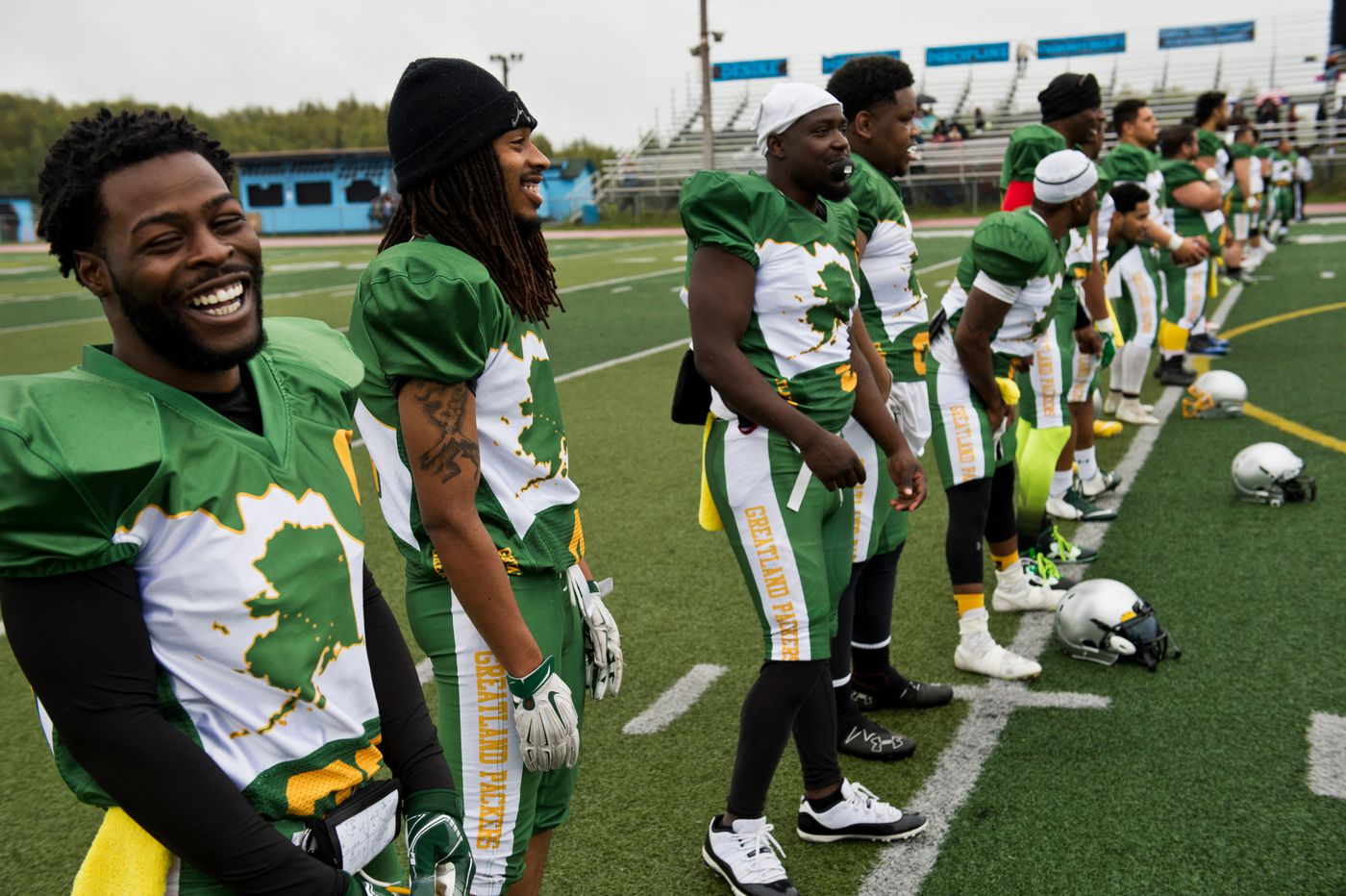 Laughing at the lighthearted taunting of players on the opposing team, 2Jordan Daniels, left, lines up with his Greatland Packers teammates before the start of a game against the Eagle River Broncos on August 26, 2018. (Marc Lester / ADN)