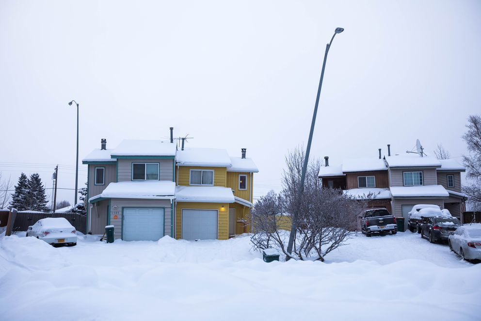 A lightpole that shifted during the Nov. 30, 2018, earthquake leans into a street in Jewel Lake on Dec. 28, 2018. Nearly a dozen homes in this cul-de-sac were yellow-tagged, indicating significant damage and in some cases advising the owners not to sleep in them. (Loren Holmes / ADN)