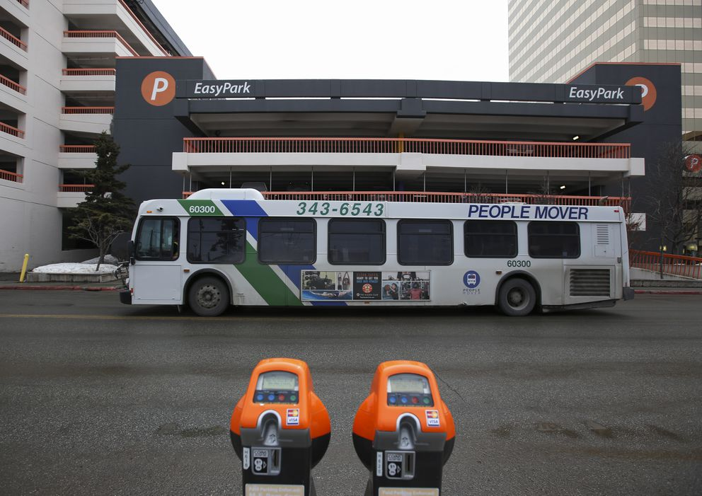 A bus drives along H Street in downtown Anchorage on Wednesday, April 14, 2021. (Emily Mesner / ADN)