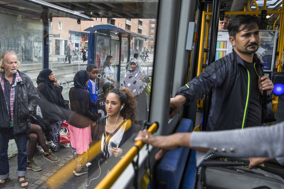 People commute in the Norrebro neighborhood of Copenhagen, Denmark, Aug. 5, 2016. The Danish government has been inadvertently paying benefits to citizens fighting for the Islamic State group in Syria, Danish officials said Tuesday. (Ilvy Njiokiktjien/The New York Times file)