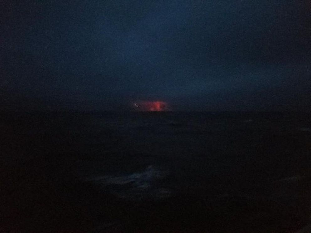 An eruption of Bogoslof volcano, photographed Friday, Dec. 23, 2016 from the Coast Guard cutter Alex Haley, shows ash emission, lightning and the ejection of incandescent lava and fragmental material. (From USCG via AVO)