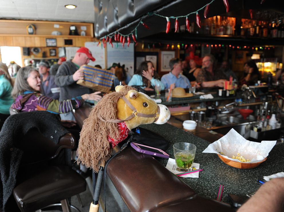 A stick horse ponies up to the bar at Darwin's Theory's. (Bob Hallinen / Alaska Dispatch News)