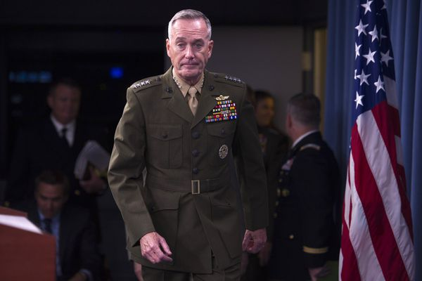 In this July 1, 2015, photo, Marine Corps Commandant Gen. Joseph Dunford walks onstage for a news media at the Pentagon. Dunford has been nominated to be the next Chairman of the Joint Chiefs of Staff and says the U.S. and its coalition partners are making moderate progress in the fight against the Islamic State but that the strategy should be re-evaluated if efforts to improve governance and build reliable local ground forces stall.