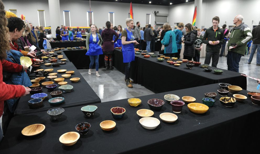 People choose a bowl during the Empty Bowl Project at the Dena'ina Center in downtown Anchorage on Saturday. (Bob Hallinen / ADN)