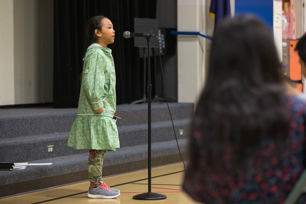 Chevak 3rd grader Auna Friday spells a word during the Statewide Yup'ik Spelling Bee for Beginners Saturday, April 13, 2019, at College Gate Elementary School. Friday won second in the competition. (Loren Holmes / ADN)