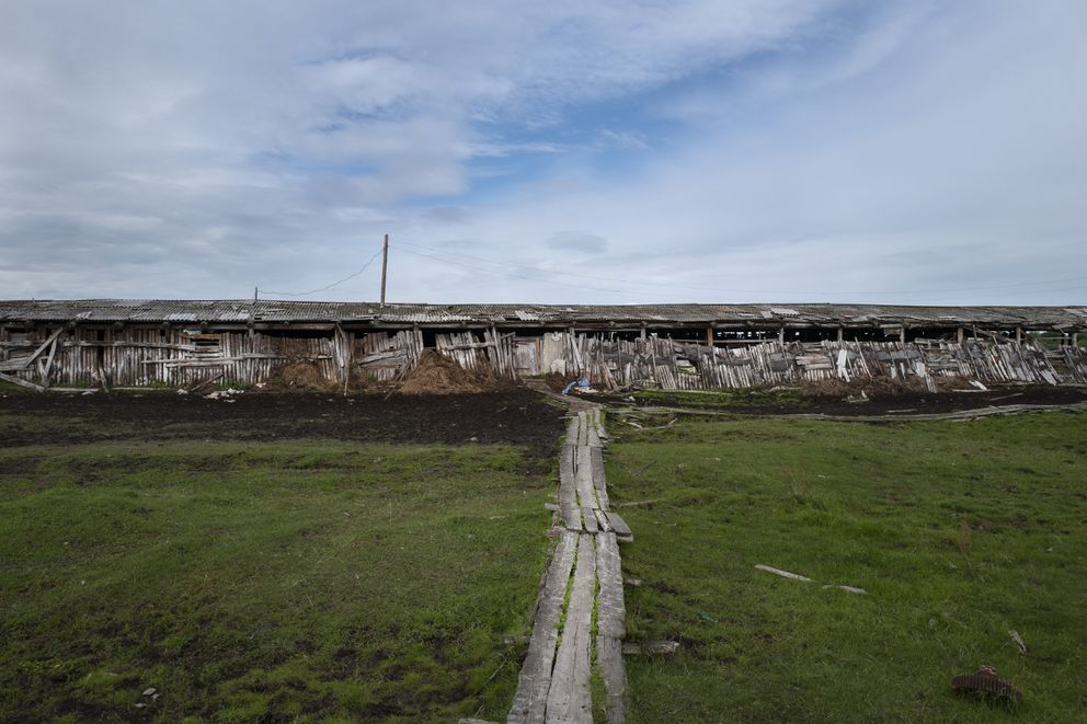 A building at a stockyard near Zyryanka illustrates the effects of the shifting ground. (Washington Post photo by Michael Robinson Chavez)
