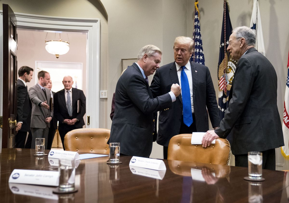 President Donald Trump speaks with Sen. Lindsey Graham (R-S.C.), left, and Sen. Chuck Grassley (R-Iowa) during a meeting on immigration the White House on Jan. 4, 2018.  (Doug Mills/The New York Times)