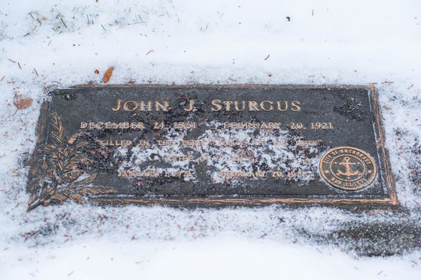 The grave marker for John Sturgus, Anchorage's first chief of police, photographed Thursday, Jan. 9, 2020 at the Anchorage Memorial Park Cemetery. (Loren Holmes / ADN)