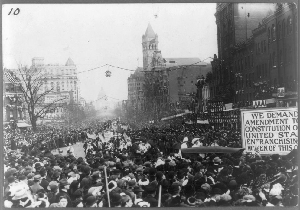 An enormous crowd gathers along Pennsylvania Avenue to watch the parade to promote women's rights. MUST CREDIT: Library of Congress