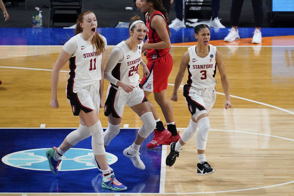 Stanford forward Ashten Prechtel (11), guard Lacie Hull (24) and guard Anna Wilson (3) celebrate during the first half of the championship game against Arizona in the women's Final Four NCAA college basketball tournament, Sunday, April 4, 2021, at the Alamodome in San Antonio. (AP Photo/Eric Gay)