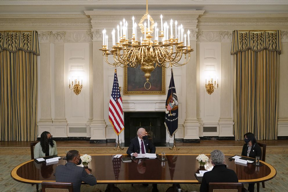 President Joe Biden participates in a roundtable discussion on a coronavirus relief package in the State Dining Room of the White House on Friday. (Patrick Semansky / AP)