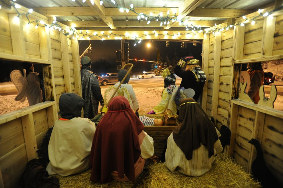 Members of the Christian Church of Anchorage take part in a living Nativity scene. (Bob Hallinen / Alaska Dispatch News)