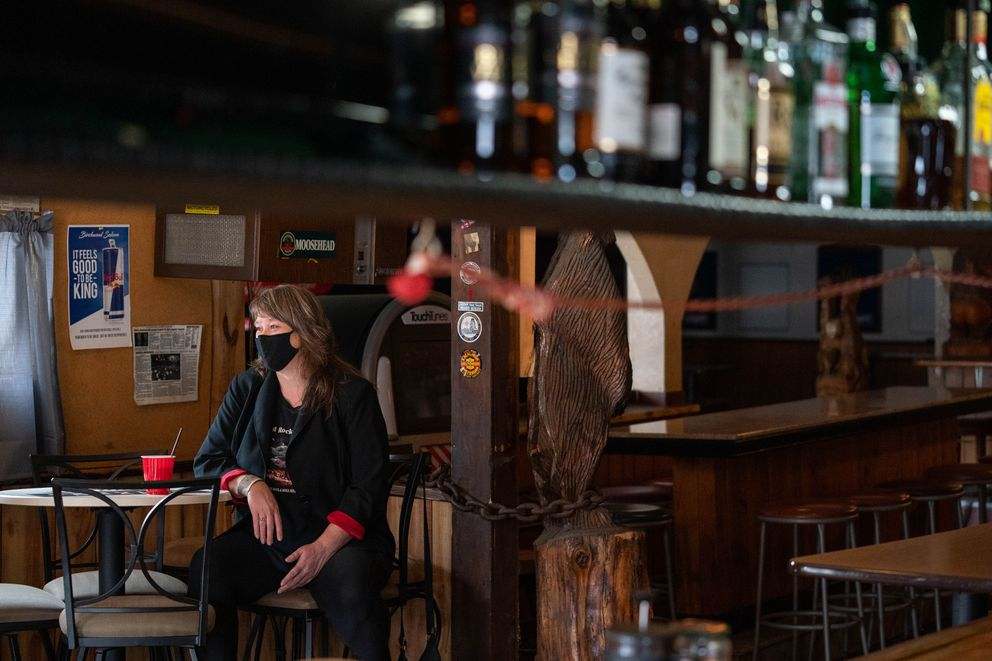 Jo Rainwater, a furloughed bartender at Birchwood Saloon in Chugiak, photographed at the bar on Saturday, Jan. 23, 2021. Rainwater has been helping area seniors sign up for COVID-19 vaccine appointments. (Loren Holmes / ADN)