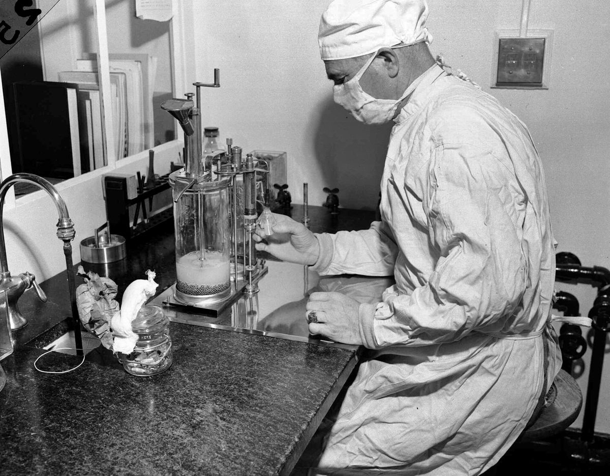 FILE - In this Dec. 2, 1947 file photo, Charles D. Brown, fills a vial with the BCG tuberculosis vaccine, at a state-operated laboratory in Albany, N.Y. Scientists are dusting off some decades-old vaccines against TB and polio to see if they could provide stopgap protection against COVID-19 until a more precise shot arrives. (AP Photo)