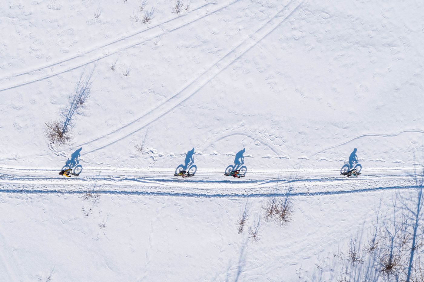 A group of friends who met on Instagram bike to the Knik Glacier on Saturday, March 27, 2021. (Loren Holmes / ADN)