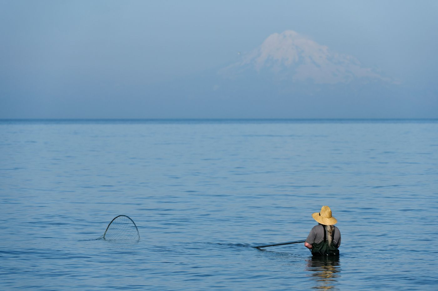 Mount Redoubt is visible on a hazy morning during the dipnet fishery. (Marc Lester / ADN)