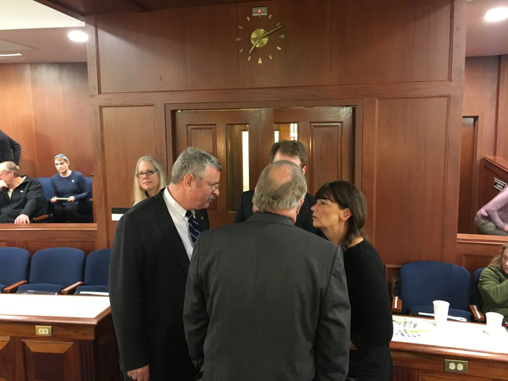 Key members of the House Republican caucus confer during a break Thursday. At left is Rep. Dan Saddler of Eagle River, at right Rep. Charisse Millett of Anchorage. They're talking to Rep. Mike Chenault of Nikiski (back to camera) and Rep. Lance Pruitt of Anchorage. (Nathaniel Herz / Alaska Dispatch News)