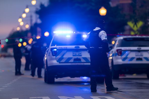 Chicago police investigate the scene of a mass shooting where more then a dozen people were shot in the Gresham neighborhood, of Chicago, Tuesday, July 21, 2020. (Tyler LaRiviere/Chicago Sun-Times via AP)